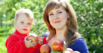 Woman and child with basket of apples